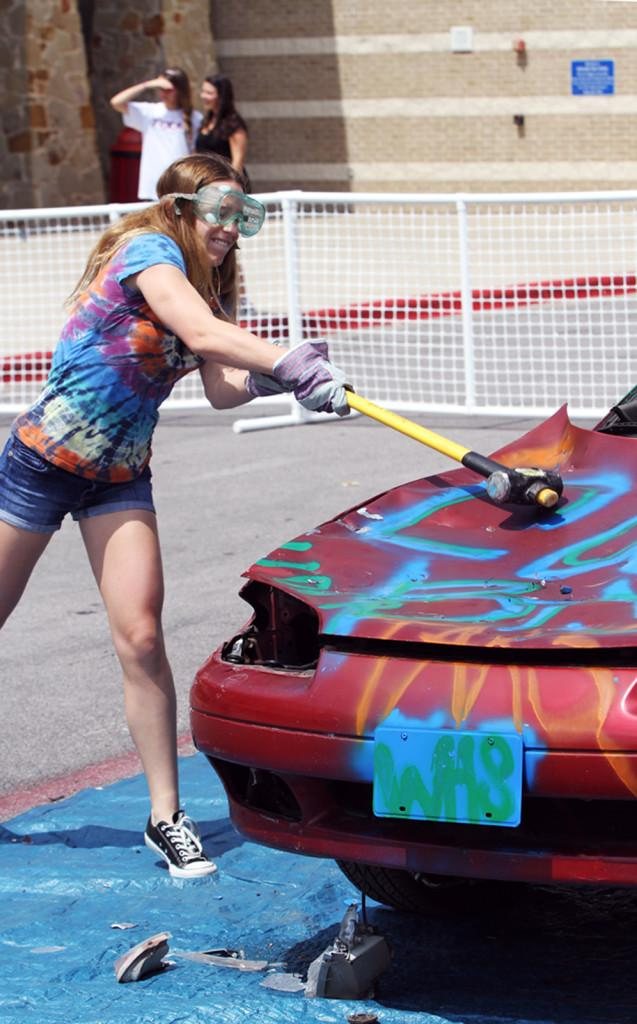 Freshman Colleen Pletcher releases some post-AP week tension as she takes part in the Teen Teaching sponsored event Car Bash on May 17.