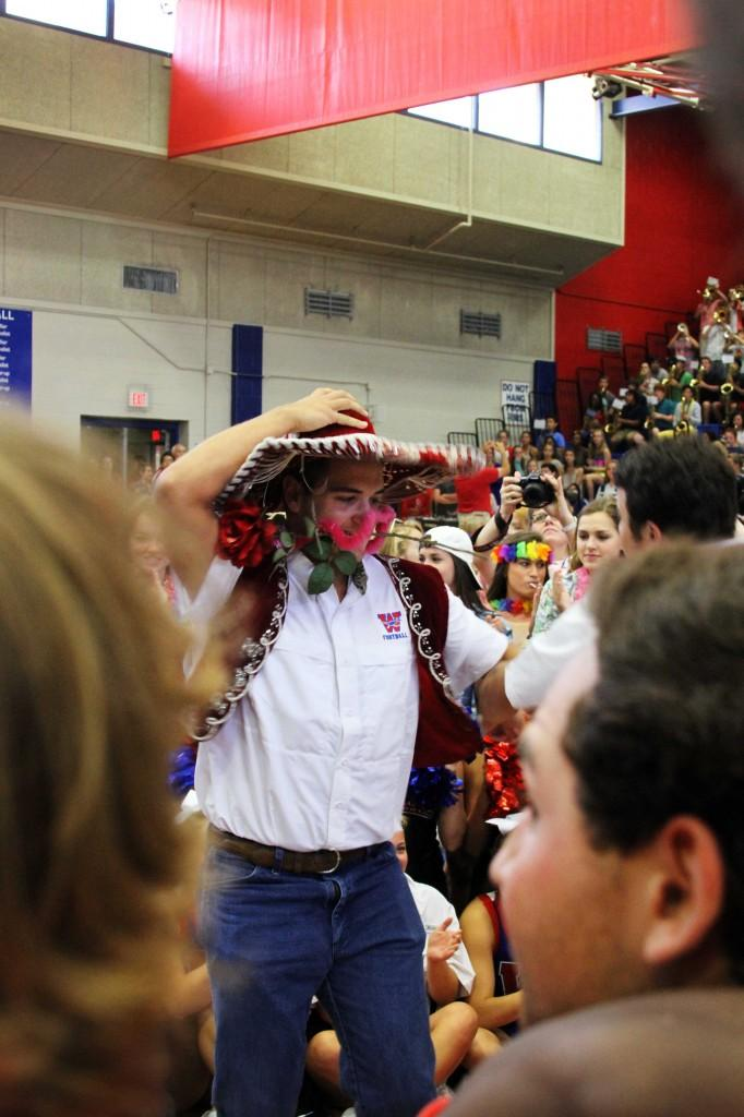 Senior Bobby Dwyer dances in the midst of other crowding seniors after they won the Spirit Stick at the first Pep Rally of the year on Aug. 30.
