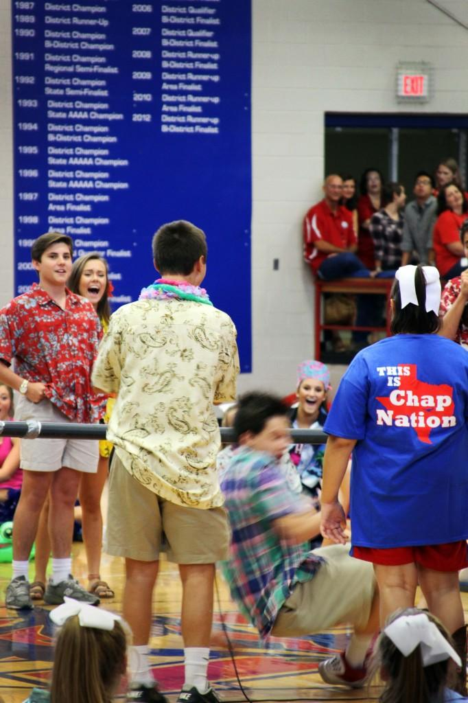 Junior Soren Stephens looks on as other students attempt doing the Limbo at the first Pep Rally of the year on Aug. 29.