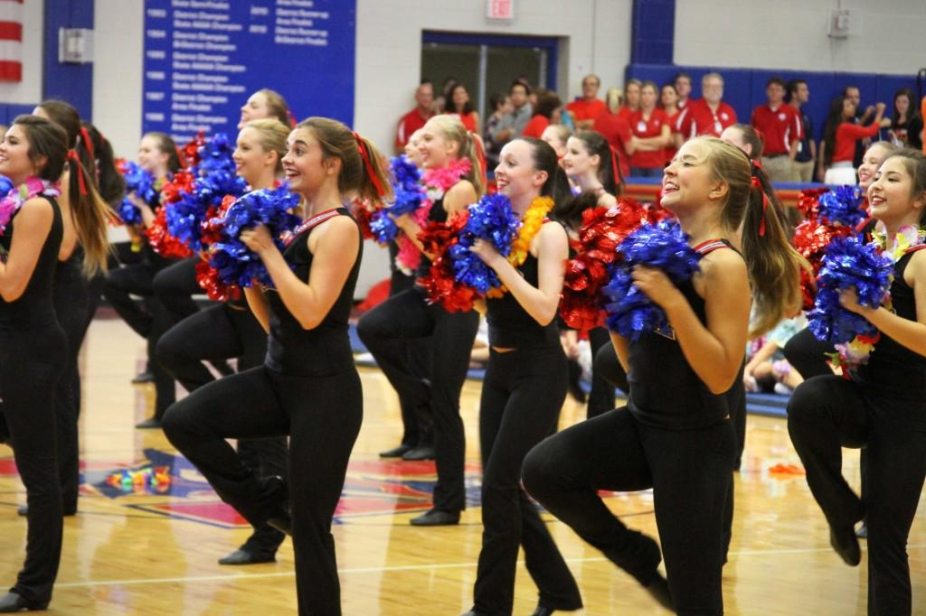 Seniors Elizabeth Brigham and Maddie Bitting dance their Hyline routine at the first Pep Rally of the year on Aug. 29.