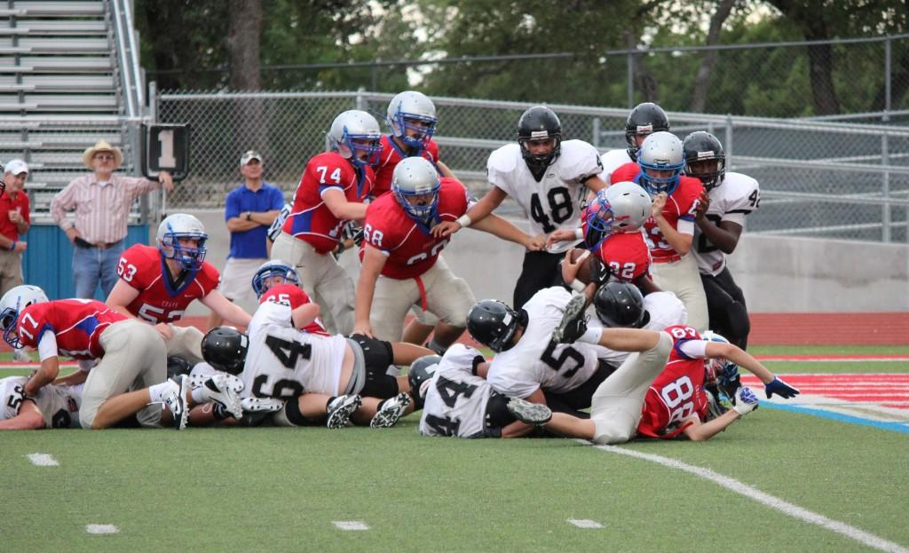 JV+Red+sophomore+Nick+French+carries+the+ball+during+the+A%26M+Consolidated+game+Sept.+19.