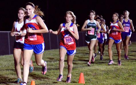Senior Rebekah Priddy, freshman Babo Fagerberg, and junior Rachel Martinez run in the Chaparral Invitational on Oct. 11. The Lady Chaps finished second in the meet.