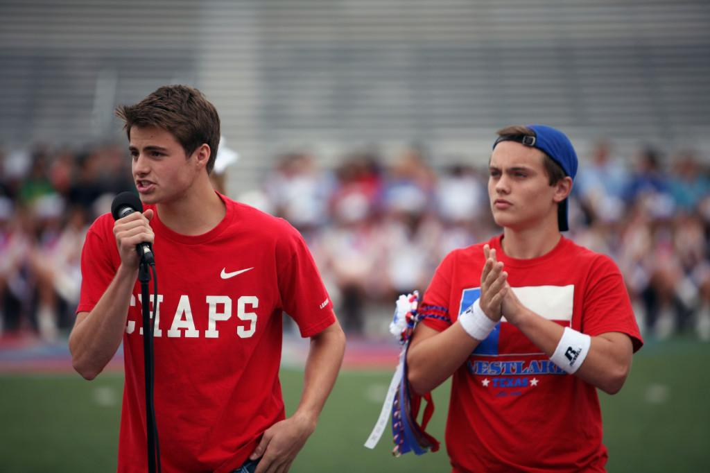 Seniors Luke Rowan and Bobby Perry, the MCs for the pep rallies, talk to a crowd of high schoolers.
