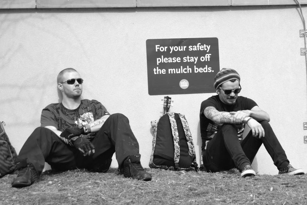 Two+SXSW+patrons+sit+in+the+mulch+bed+that+they+are+restricted+from.+There+was+a+small+turnout+at+the+Quantum+Party+on+Saturday+March+15.+They+didn%27t+choose+the+thug+life%2C+the+thug+life+chose+them.