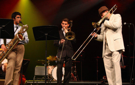 Freshmen Michel Gonzalez and Rohan Pillay play with guest performer Mike Mortacai during the Jazz Band concert on May 9.