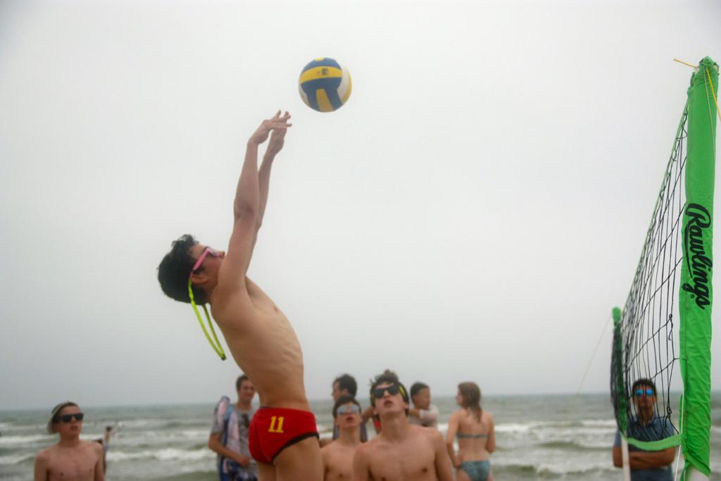 Memembers of the band play beach volleyball during their recent trip to Corpus Christi. The band participated in a concert competition and then spent the rest of the weekend relaxing and playing.
