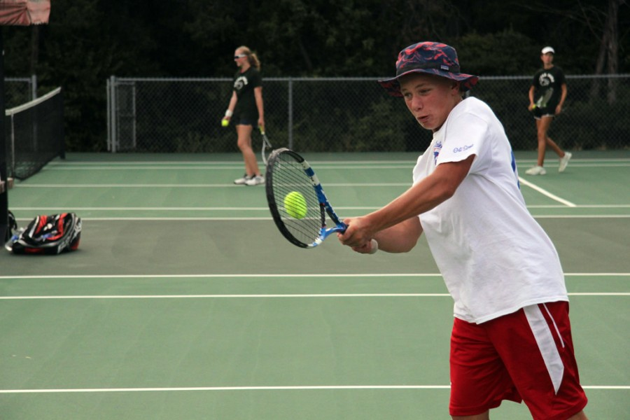Junior Travis Fulcher returns the tennis ball to his Cedar Park opponents on Friday August 29, 2014.