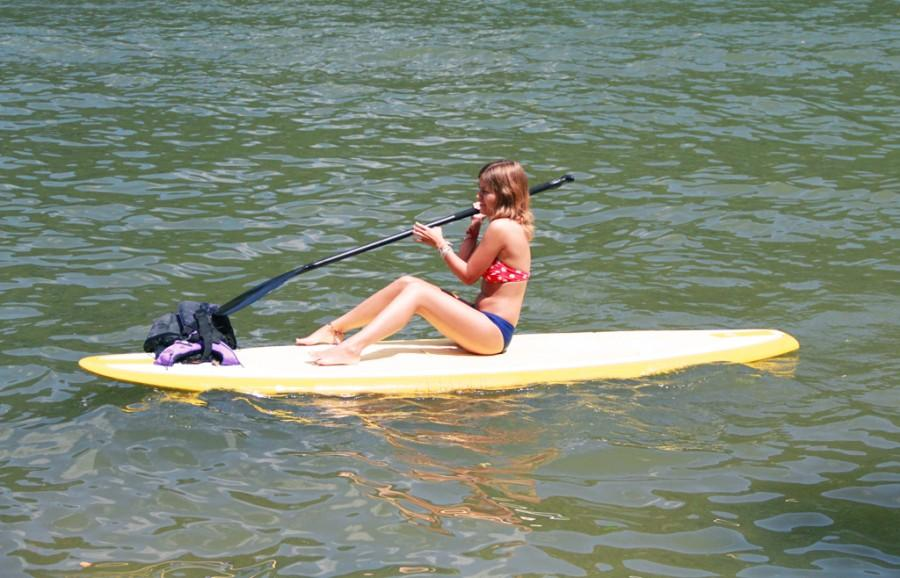 In the early afternoon of Sept.1, sophomore Sage Sutton paddle-boards at Lake Hills Comunity Association Park.