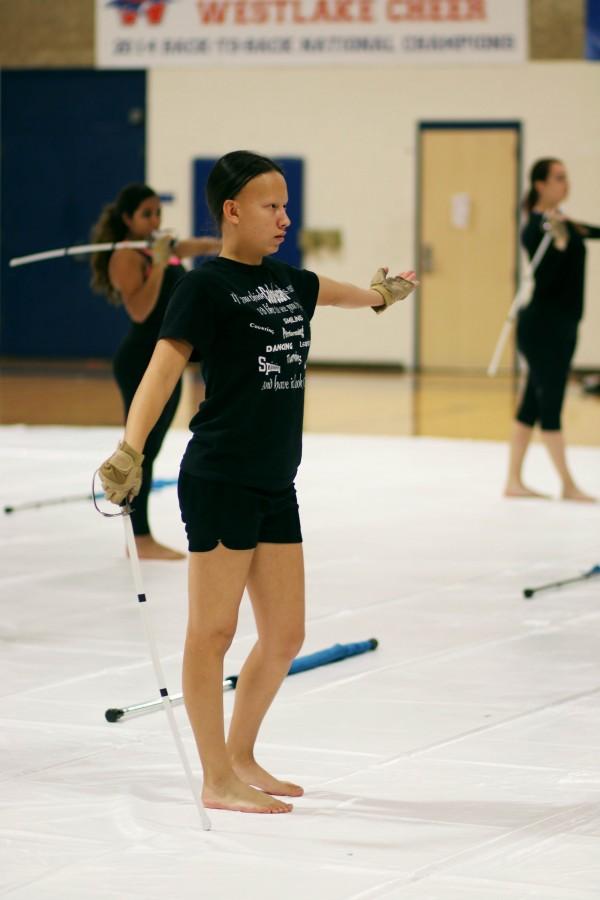 Senior Ashley Wilson strikes a pose while using saber during practice.