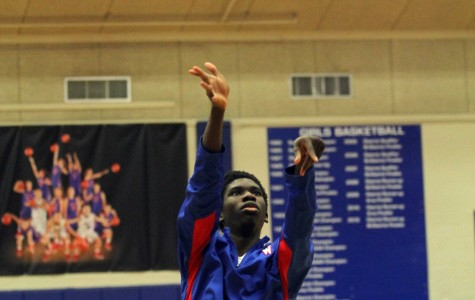 Warming up, senior Stephen Odunsi shoots baskets before a thursday game against Lehman. The chaps beat Lehman 46-33.