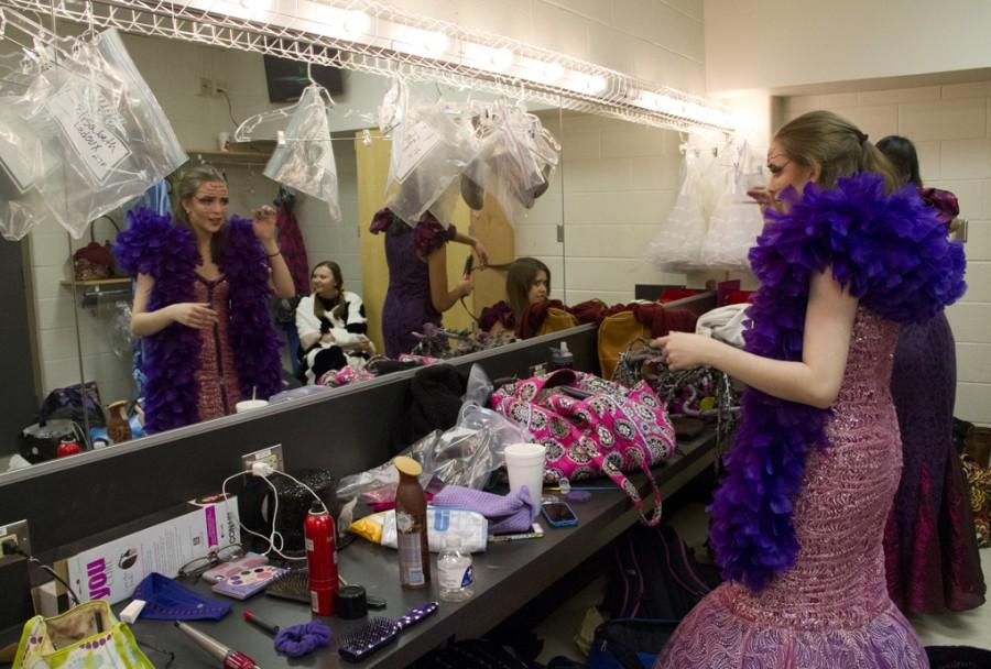 Senior Susannah Crowell gets ready to play her part of the dragon for the dress rehearsal on Feb. 4.