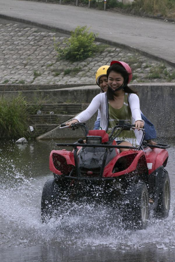 Seniors Maya Iwata and Upasana Prabhu ride their ATV over a low water crossing in Gyeongju, South Korea.