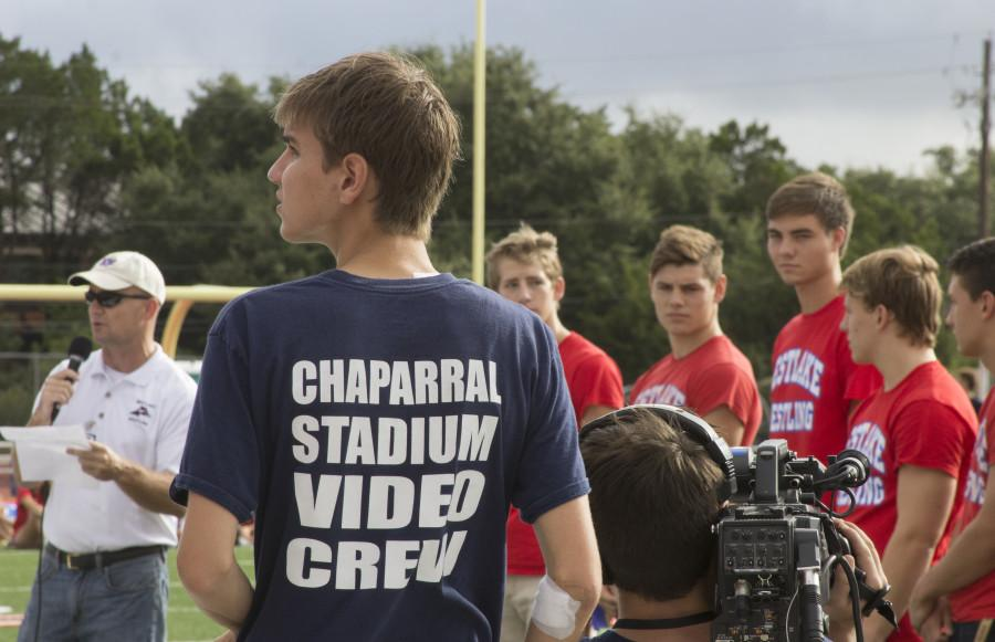 The Chaparral Stadium Video Crew shoots the varsity wrestling team on September 18, 2015 during the Homecoming Peprally.