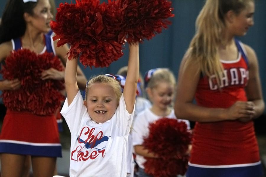 A Chap cheerleader in training roots for the Chaps at the Homecoming game on Friday, September 18th.