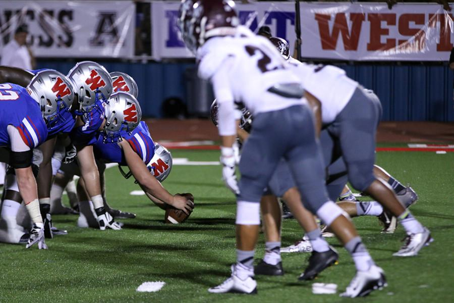 The Chap's offensive line faces off against Austin High's defensive line during the homecoming game on September 18th.