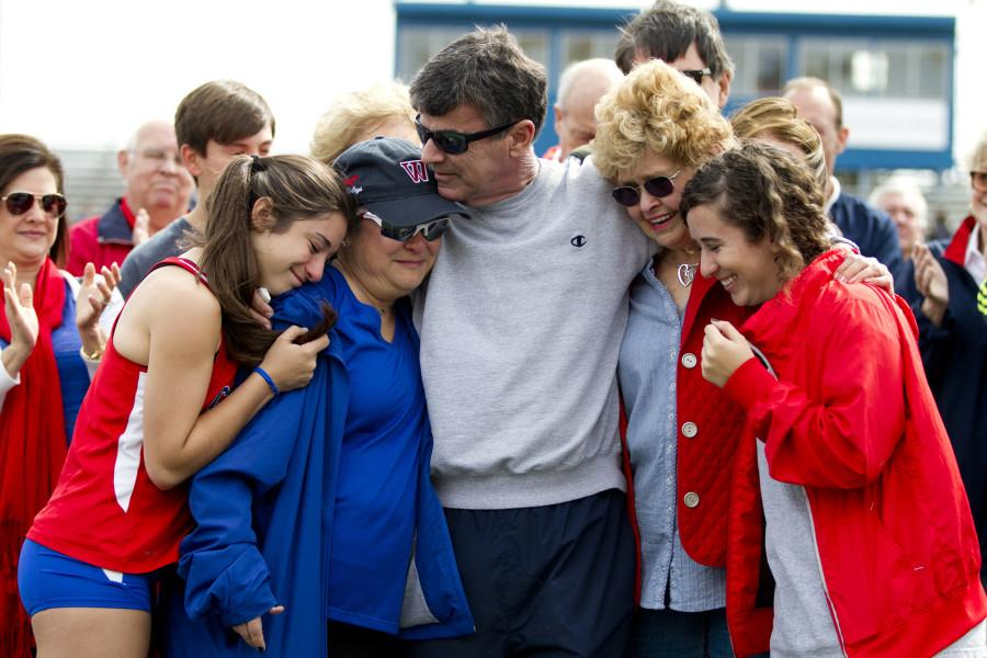 Mark Hurst celebrates with his family and friends on Feb. 22, 2014 at the surprise ceremony renaming the Westlake track after him. Pictured with Hurst are his daughters, Abby and Hillary, his wife, Judy, and Mary Sue Neptune, the wife of former coach Ebbie Neptune, a mentor of Hurst's.