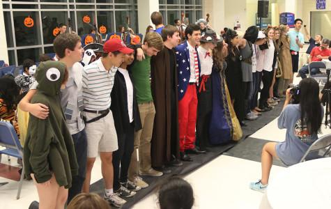 Orchestra senior students join togeher at the Halloween concert to celebrate their years in orchestra on Oct.27.