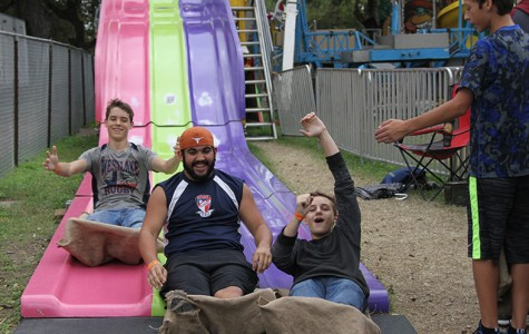 Sophomores James Perdue, Noah Shelton, and Davin Intag race down a slide at the Wurstfest in New Braunfels on Nov. 11. The Wurstfest is an annual German sausage fest where people enjoy traditional German food and music.