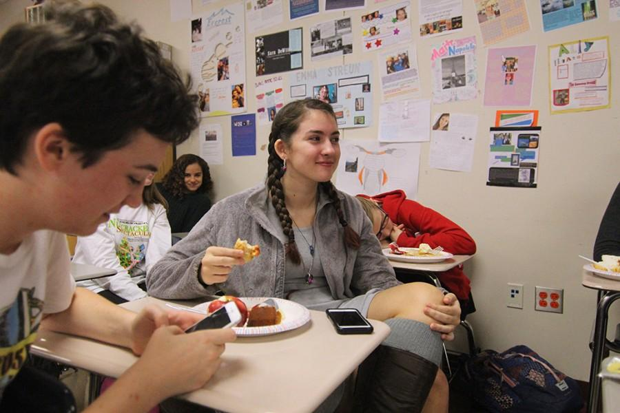 Freshmen Emerson Stack, Cristina Sallas and Lauren Parsens celebrate at the post-reading party for
