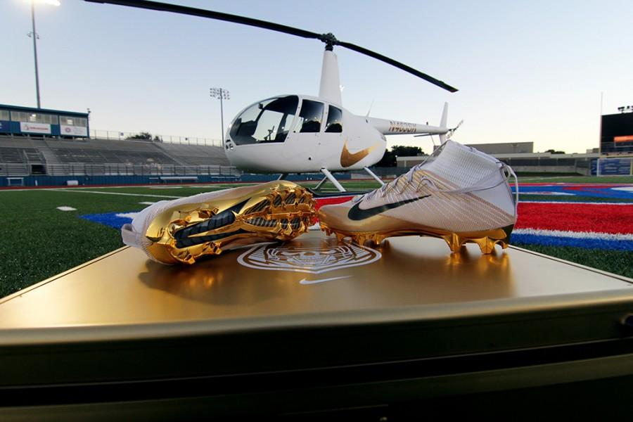 On Monday, Dec 14, Nike representatives deliver new cleats to the varsity football team.