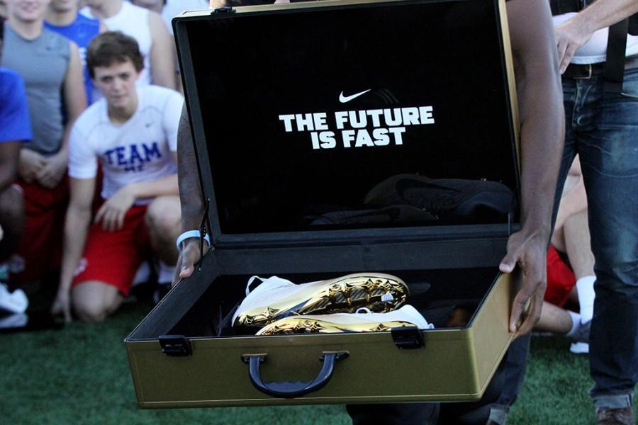 Nike representative reveals cleats to the varsity football team on Monday, Dec 14.