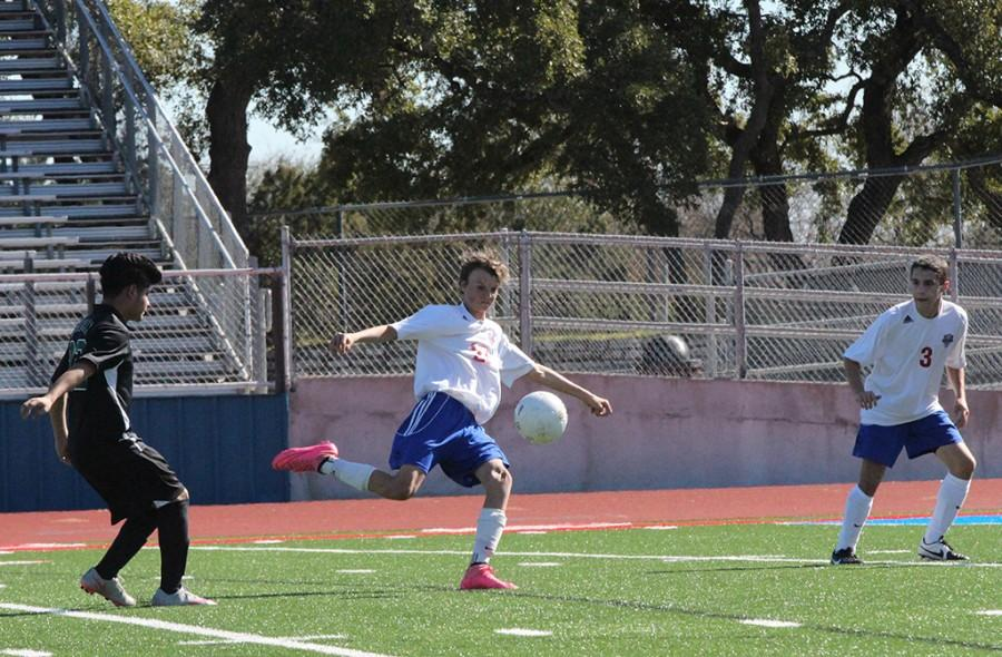 Westlake Player number 23 attempts to kick the soccor ball into the goal in order to gain another point.  by jake breedlove