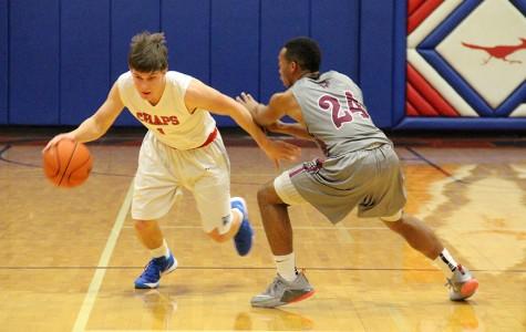 Varsity boys basketball against Austin High game report