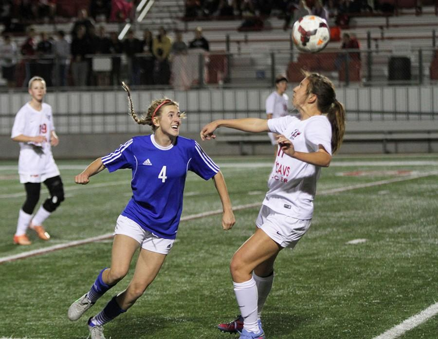 Senior varsity player Hailey Bishop fights for the ball during the game against Lake Travis on Feb. 9. The Chaps won 4-0 and will be playing Lake Travis again on March 8.