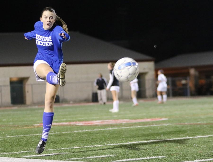 Suzanne Lightsey kicks the soccer ball during a warm-up before the girls varsity soccer game against Lake Travis on Tuesday, February 9, at 5:30pm – 9:30pm