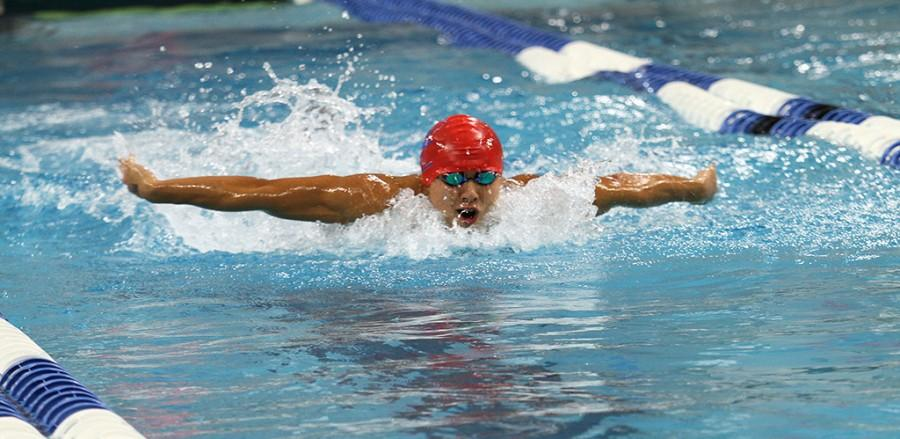 Swim team member Junior Kevin Fang swims butterfly at the Swimming a Diving State Championships on Feb. 20.