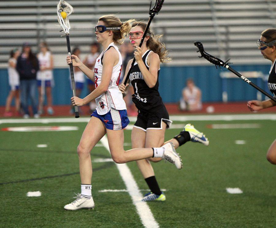 Junior lacrosse player Emily Pullen looks for a pass during a varsity lacrosse game against Vandergrift on April 13.