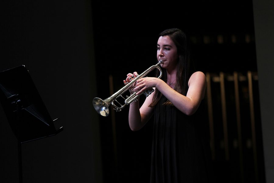 Senior Ginger Hooper plays the trumpet during her solo at the band concert on May 13.