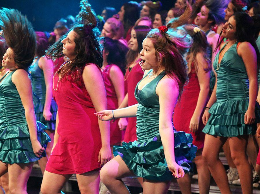 Members of the freshman girls choir dance during their group performance at Spring Revue on May 18.