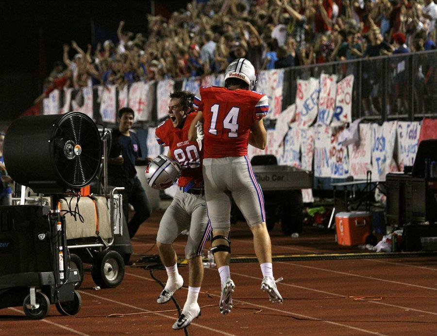 Senior Zach Brantley and junior Grayson Burks celebrate Andrew Boykin's touchdown against Katy on Aug. 26.