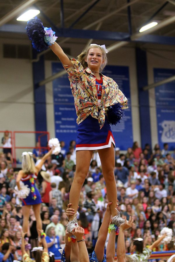 Freshman cheerleader Harper Didlake cheers with her team during the pep rally on Aug.26.