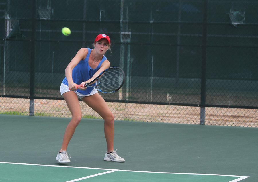 Senior Alex Rienhart prepares to hit the ball during her match against Cedar Park on August 25.