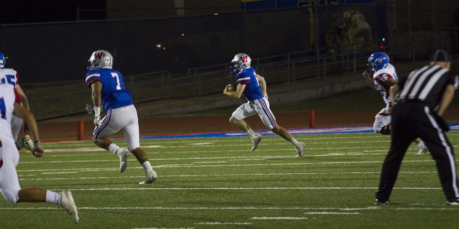 Senior Matthew Gense carries the ball for the Chaps on the night of Spet. 30 against Hays. Matthew helped lead the team to a 41-14 win.