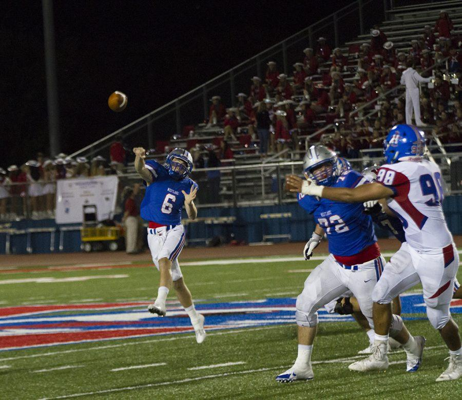 Senior Matthew Gense passes the ball during the 4th quarter at Westlake's home game on Friday Sept. 30 against the Hays Rebels.