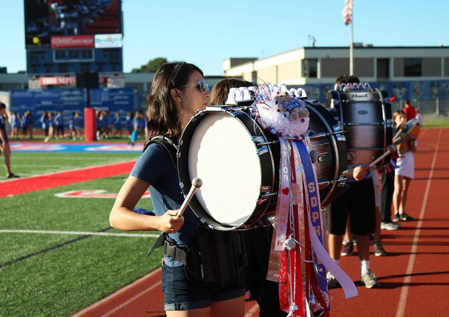 Junior Sophie Guess plays with Drumline at the homecoming pep-rally on Oct. 21.