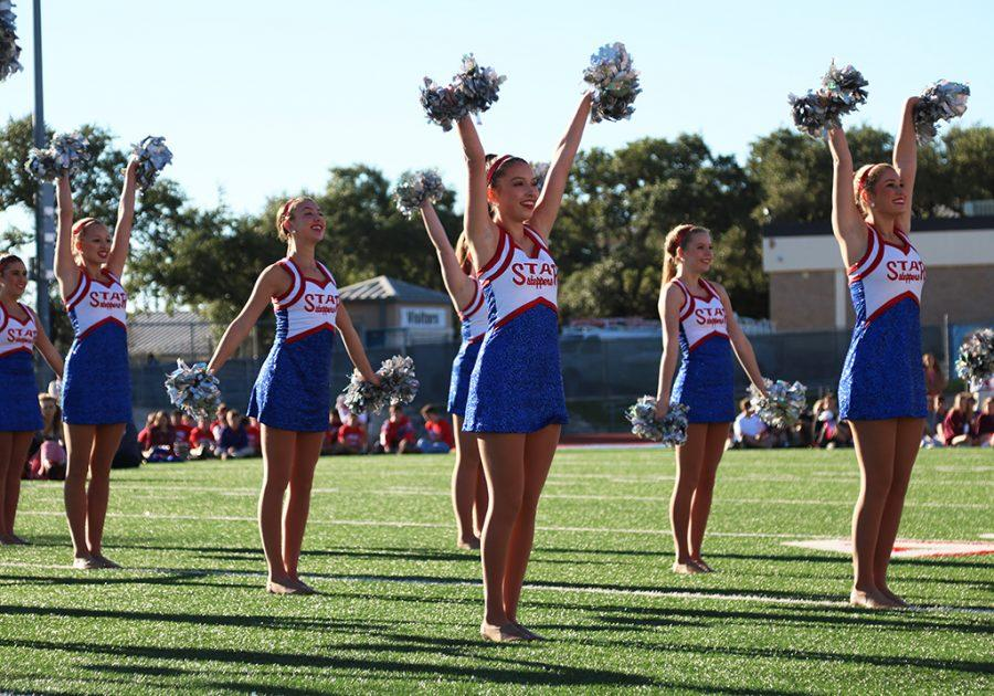 The Starsteppers  perform their pom routine at the homecoming pep-rally on Oct. 21.