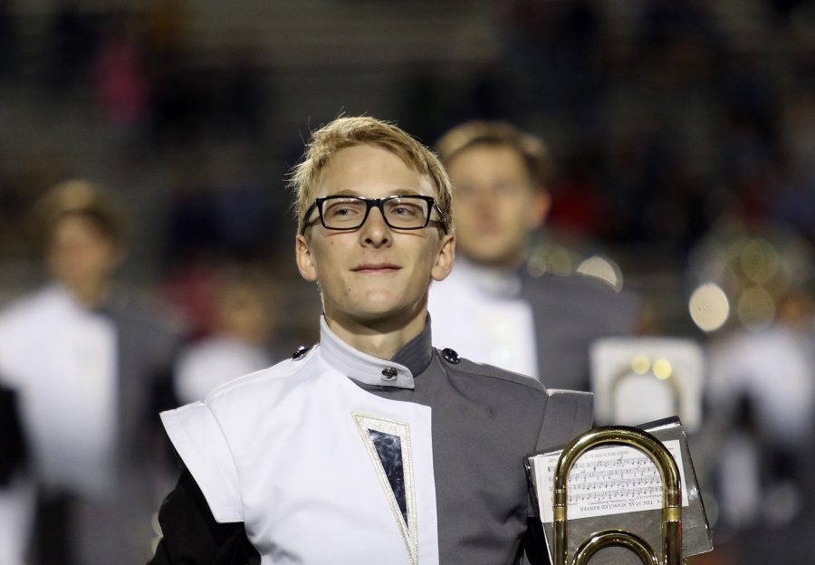 Junior Ted McManus performs with the band duruing the homecoming game on Oct.21.