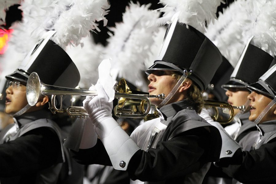 Senior trumpet player Liam Lord marches during the haltime show at the game against Vanderift on Sept. 23.