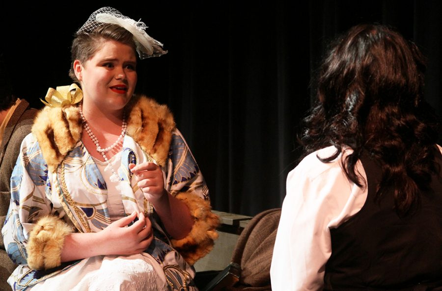 Helen Hobart (senior Zoë Ashton) talks with May (senior Emily Weller) during the Once in a Lifetime Black Box theater production on Oct. 29.