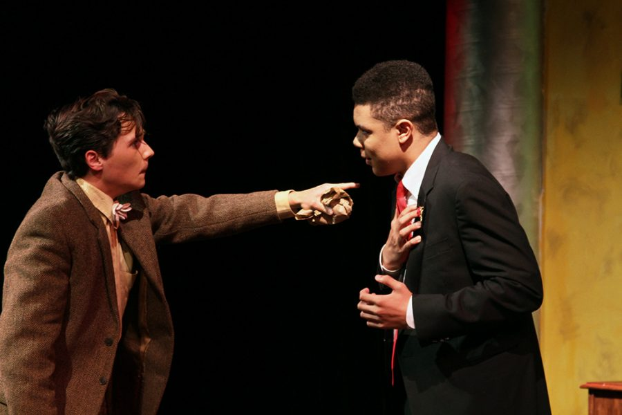 Senior Holden Pizzolato and Theo Abalogu act argue during the Black Box theater production of Once in a Lifetime with Holden as George, and Theo as Glogauer.