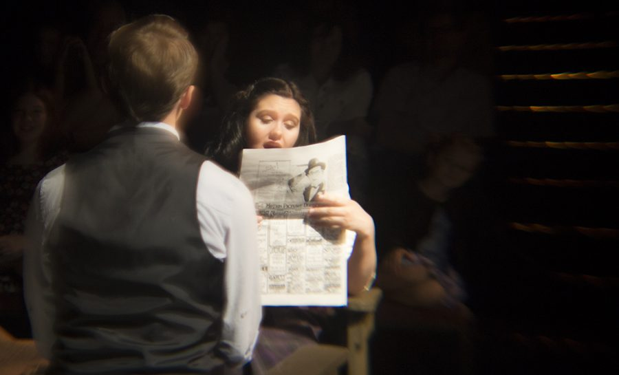 May (Senior Emily Weller) reads aloud the verdict for her previous partners play to the train car.