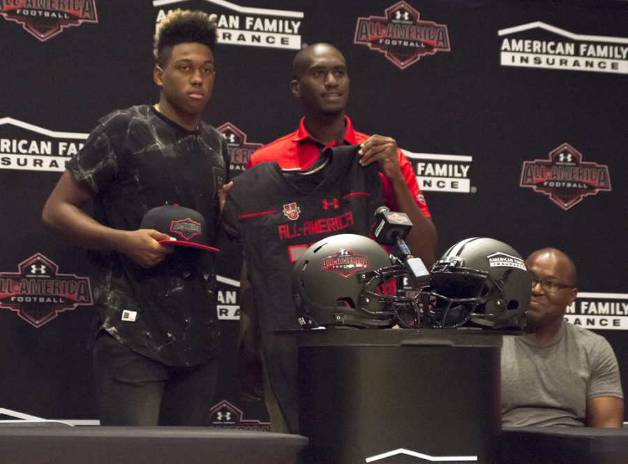 Senior Levi Jones getting his all american jersey and hat during a press conference to announce his participation.
