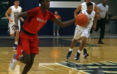 Varsity basketball loses season opener to McNeil