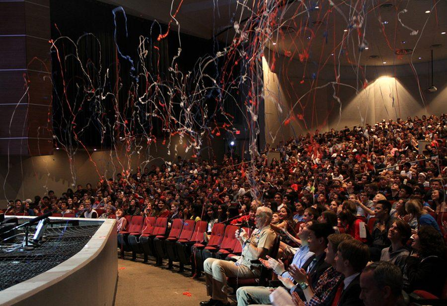 Indoor streamers explode during the Veteran's Day Assembly in the PAC on Nov. 11.