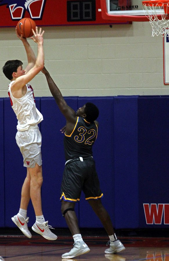 Sophomore Will Baker tries to get a shot past Anderson.