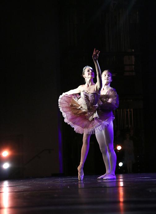 Senior Monroe Cline andUT student Connor Timpe dance as the Sugar Plum Fairy and Sugar Plum Prince in the Nutcracker Spectacular.